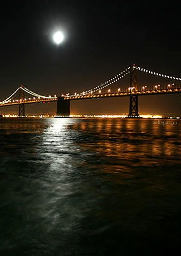 San Francisco - Oakland Bay Bridge at night from the ferry - photo by Will Spargur
