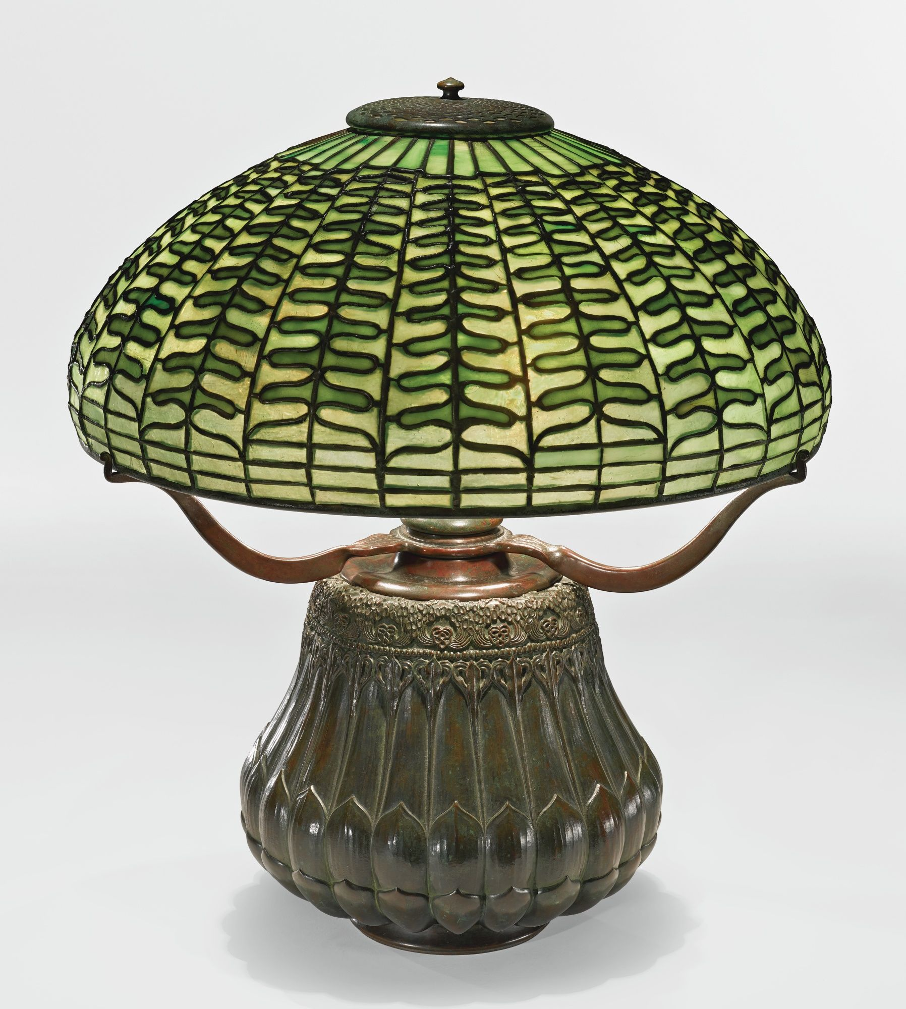 """Tiffany Studios -  A RARE """"FERN"""" TABLE LAMP with a """"Night Blooming Cereus"""" base, leaded glass and patinated bronze, circa 1900-1902"""