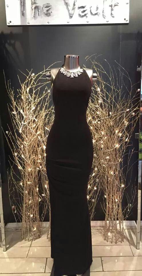 Stunning, black dress with detailed neckline