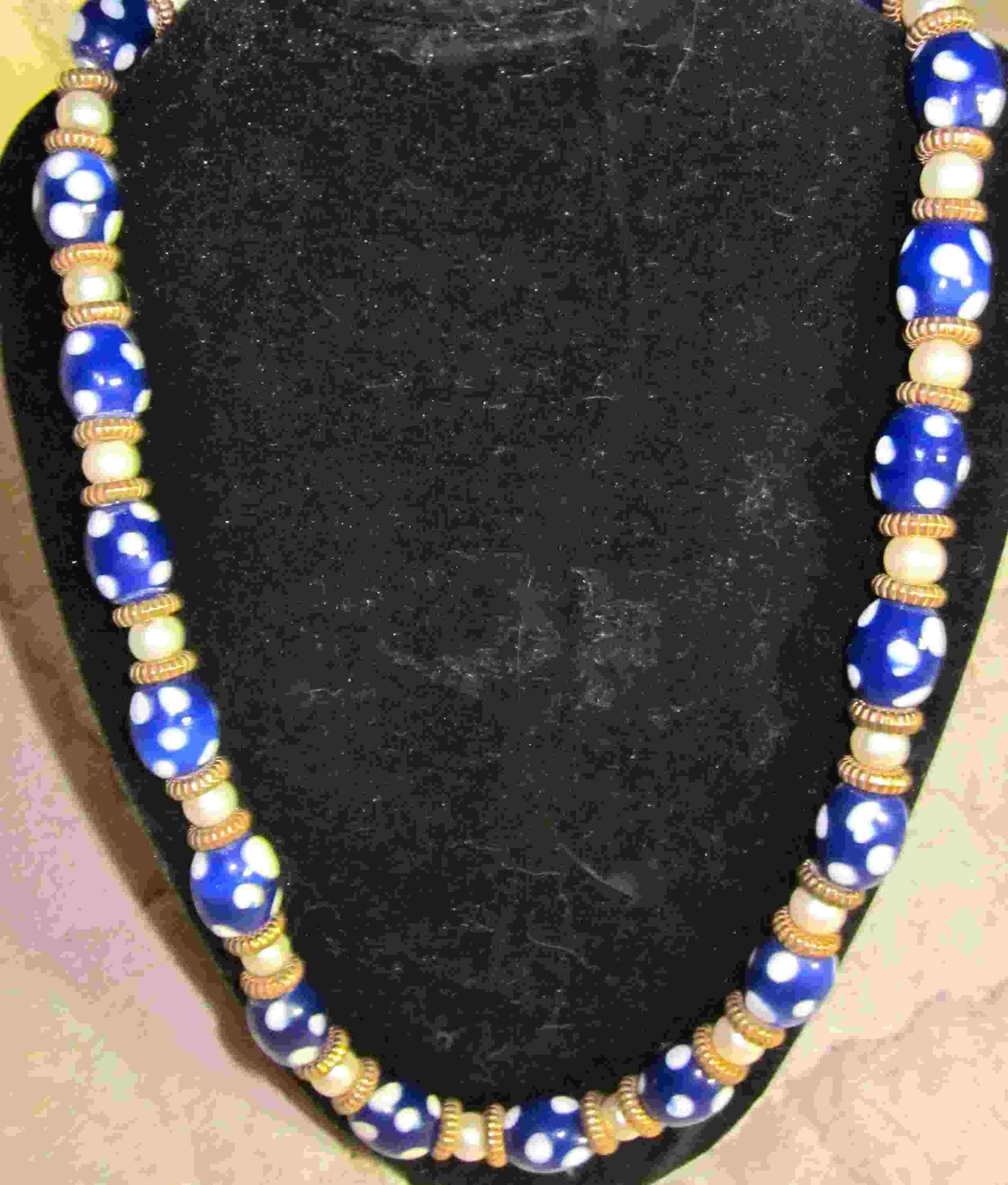 navy poka dotted necklace with gold spacers  20.00$