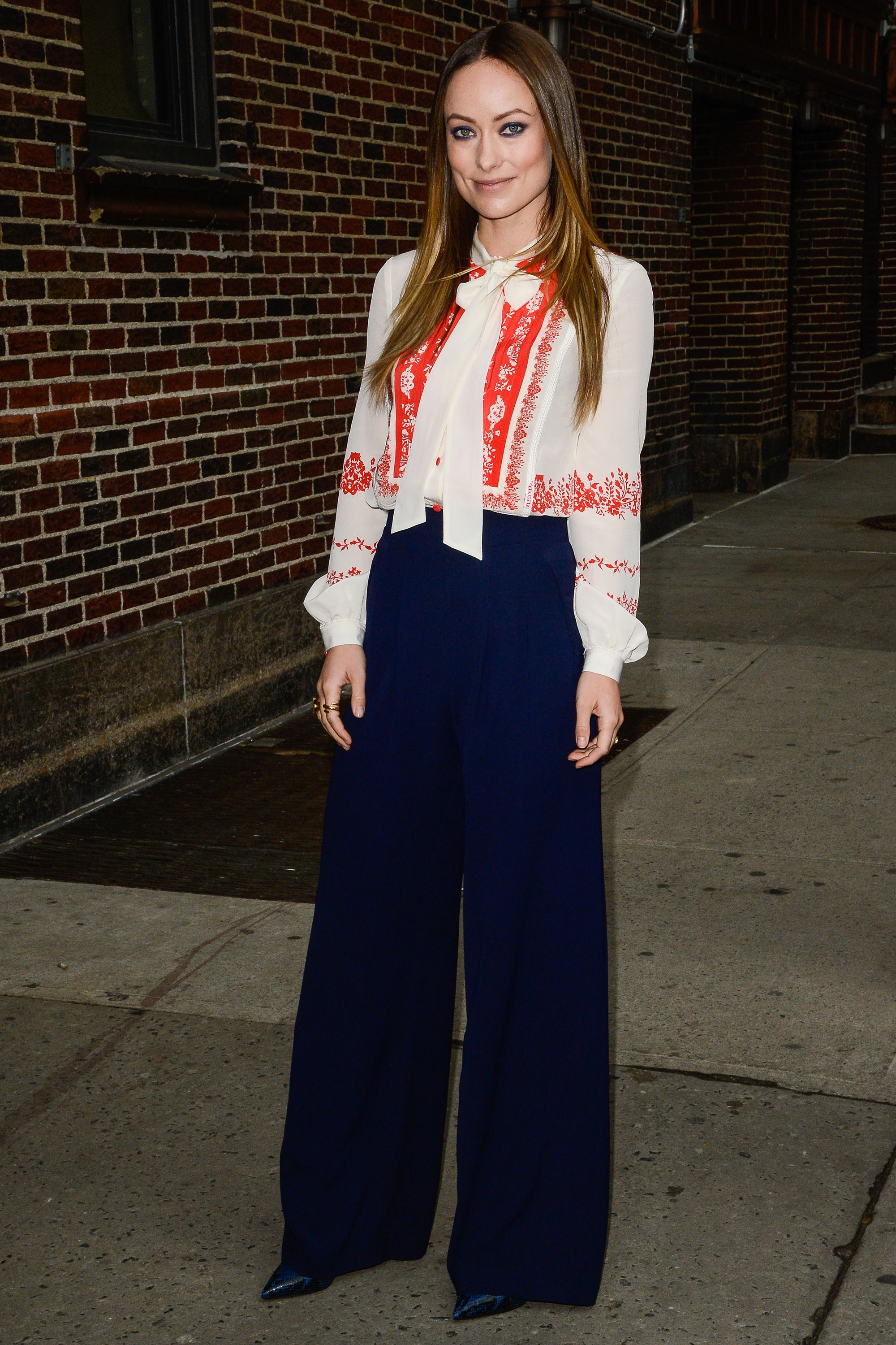 9 February Olivia Wilde wore wide-legged trousers and a printed blouse for an appearance on The Late Show With Stephen Colbert.   - HarpersBAZAAR.co.uk