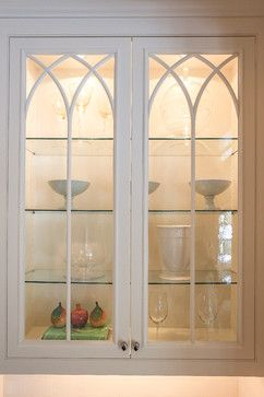 The Kitchen Cabinets Have Glass Doors And Interior Lighting Displaying The Objects Insi Glass Kitchen Cabinet Doors Glass Kitchen Cabinets Glass Cabinet Doors