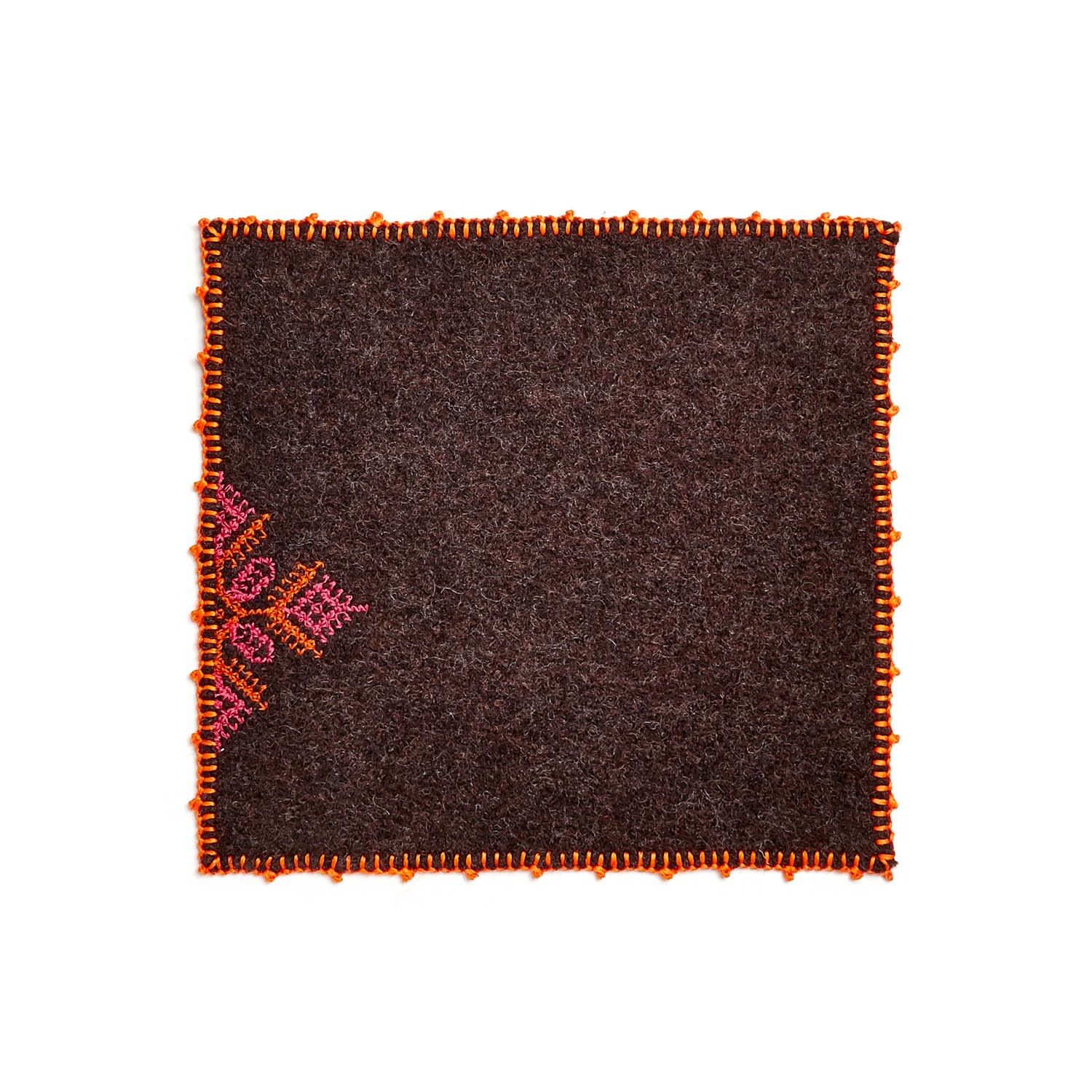 Exclusively at ABC, table mats and coasters draw inspiration from the culturally rich city of Fes. Each is embroidered with a boldly colored diamond design, evocative of the colored tiles found in Moroccan architecture. Table Mat sold below in Black, Brown, and Green. Coaster sold below in Anthracite.