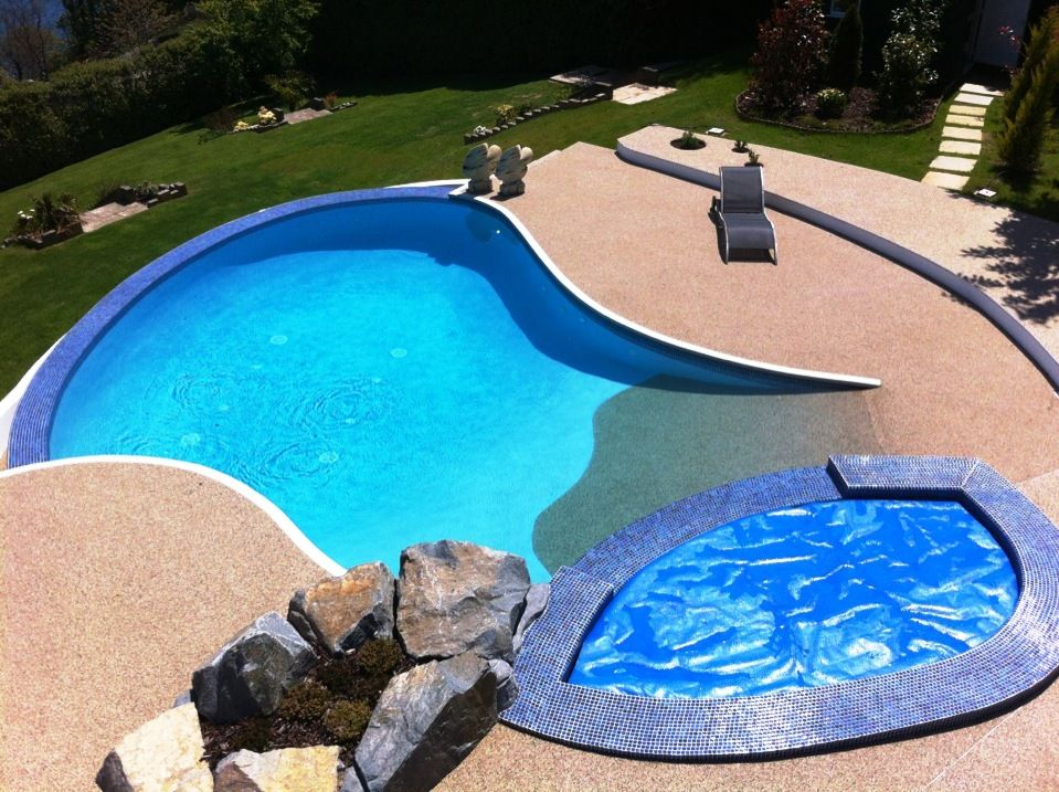 A Stunning pool surround installation by Gillingham Pools, using our SureSet Natural Gravel.