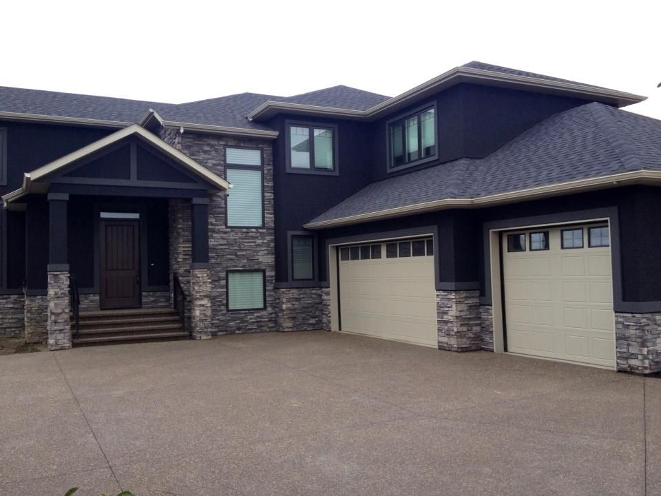 Two storey black stucco and brick house this little for Stucco and brick homes