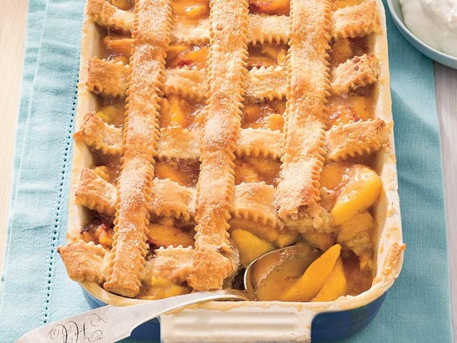 Showcase two of the South's most beloved products—peaches and pecans—in this old-fashioned peach cobbler recipe. #peachcobblercheesecake