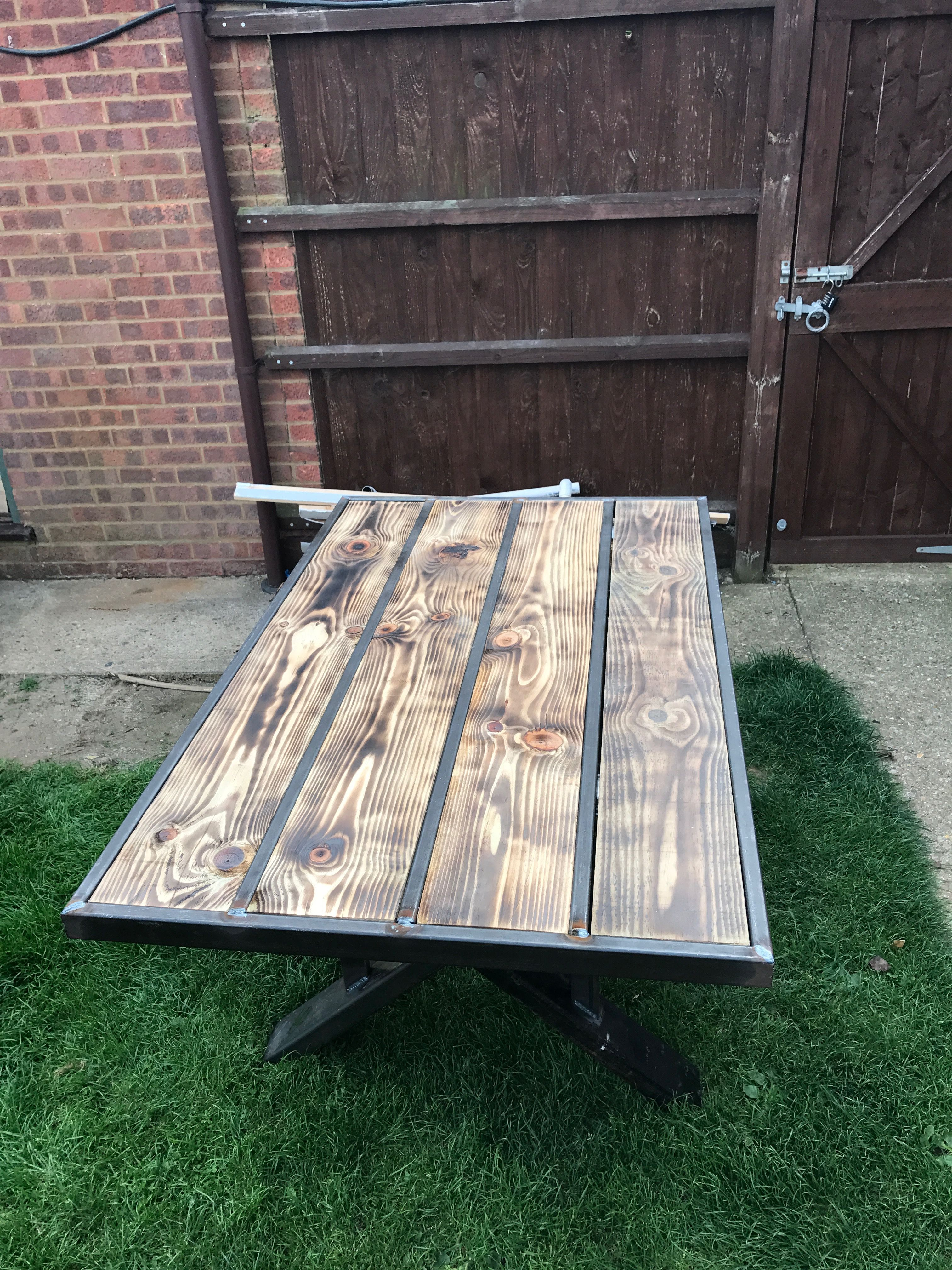 This is a patio table, but with some adjustments it can be a desk, or a dinning room table. Can be made any length or height starts at £1500.00