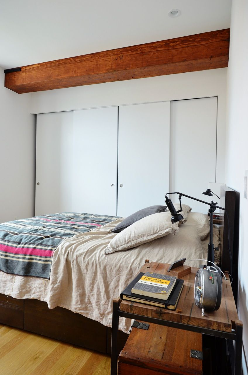 House Tour: History & Minimal, Modern Style in Brooklyn | Apartment Therapy - Rustic exposed beams and rustic decor combined with simple, modern furniture makes for an industrial modern city living style with clean lines and tons of personality.