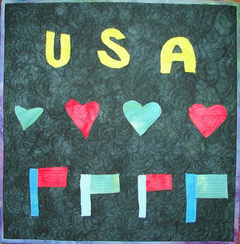 Art quilt made with child. Fused appliqué art quilt made for veterans.