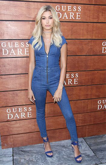 0055598e63d6 Hailey Baldwin wearing a Guess Jessie Denim Utility Jumpsuit  https   api.shopstyle