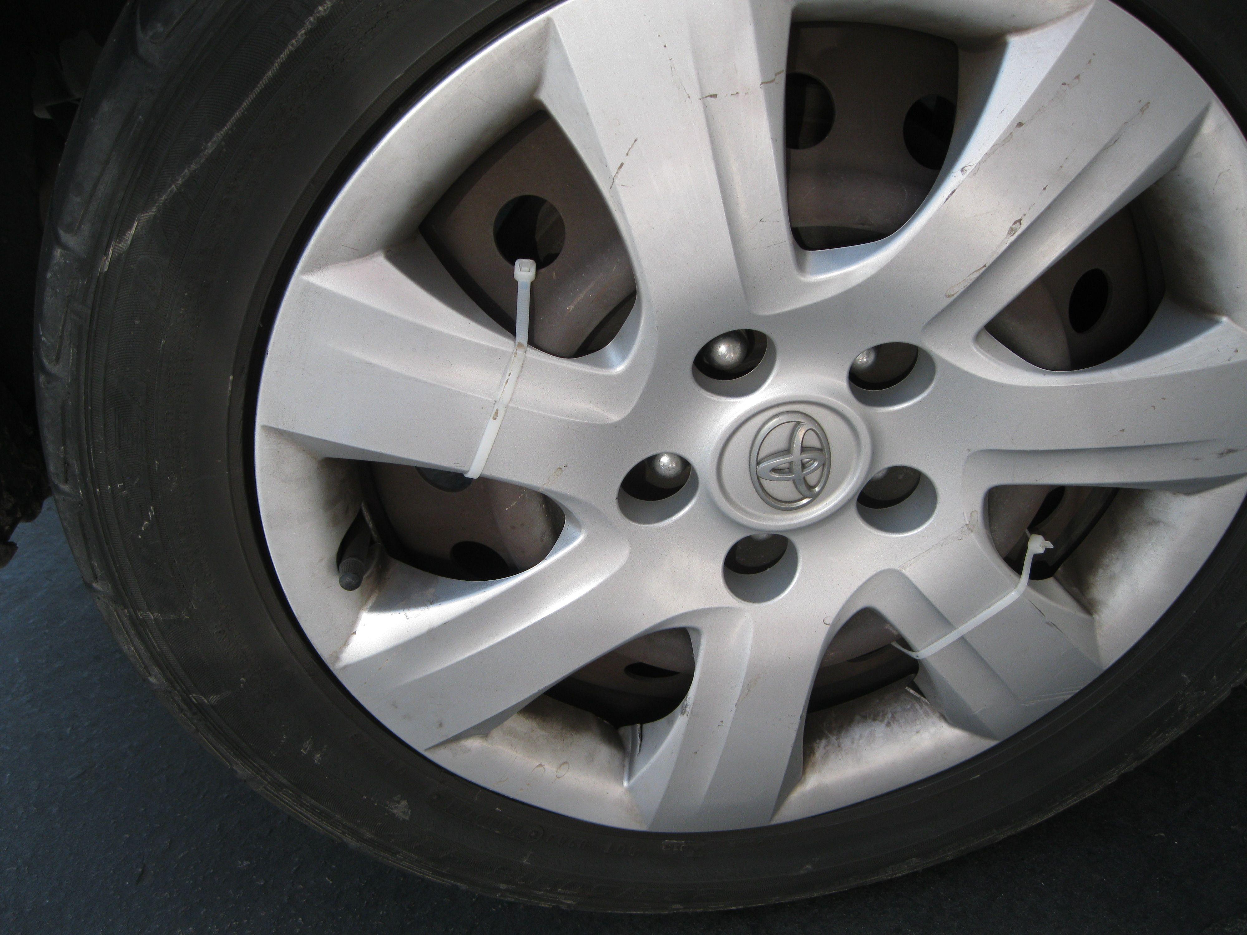Zip ties keep plastic hubcaps in place.