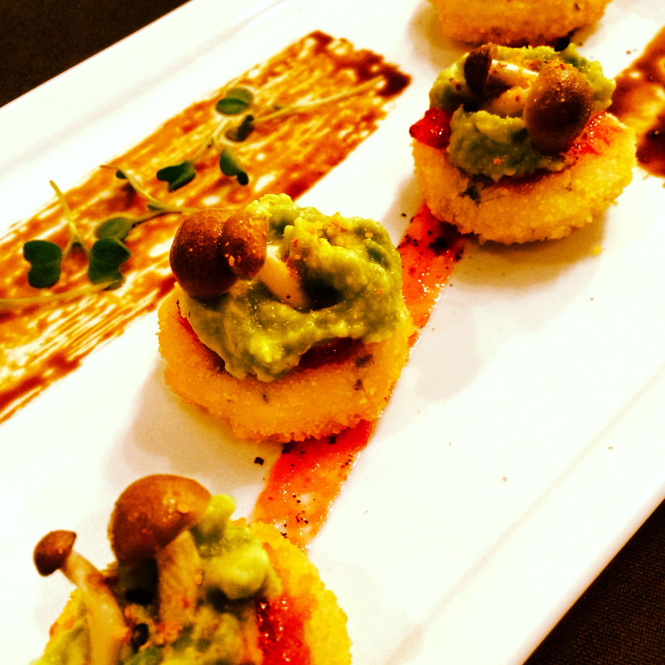 Cilantro rice cake with pickled mushrooms and avocado