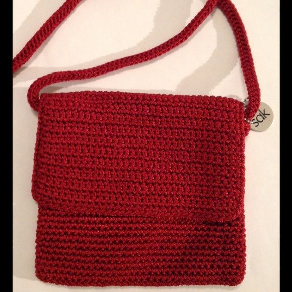 The Sak red crochet crossbody The sak small red crossbody bag, zipper closure with 1 zipper pocket inside. New never used but no tag. The Sak Bags Crossbody Bags