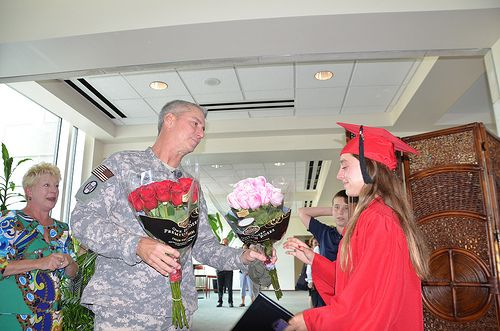RALEIGH, N.C. --   Army Lt. Col. Marty Reigher, a deployed North Carolina National Guard officer on leave, surprises his daughter Anna at her high school graduation held at Raleigh's Memorial Auditorium here June 11.