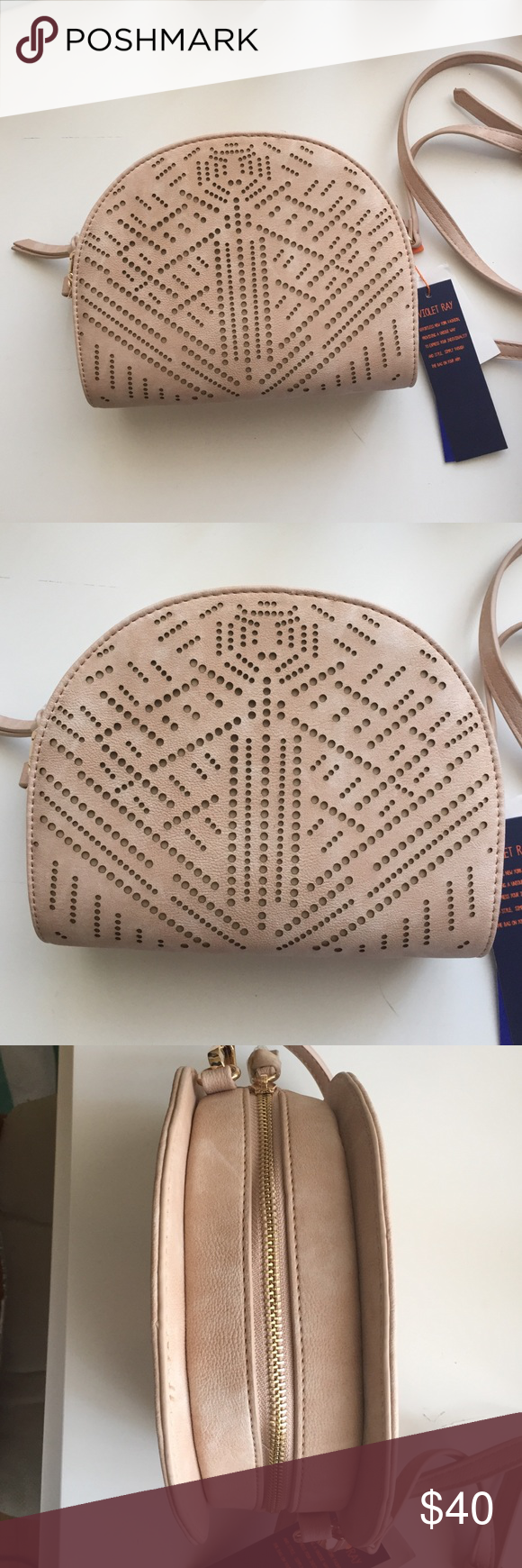 ❗️REDUCED❗️Blush Pink Satchel Has adjustable straps which also detach completely to make this a clutch if you'd like. Has an Aztec hole print design with 2 shades of pink a medium and light color to produce this beautiful blush color. Small and light would fit all your necessities like wallet, phone, etc. Violet Ray Bags Crossbody Bags