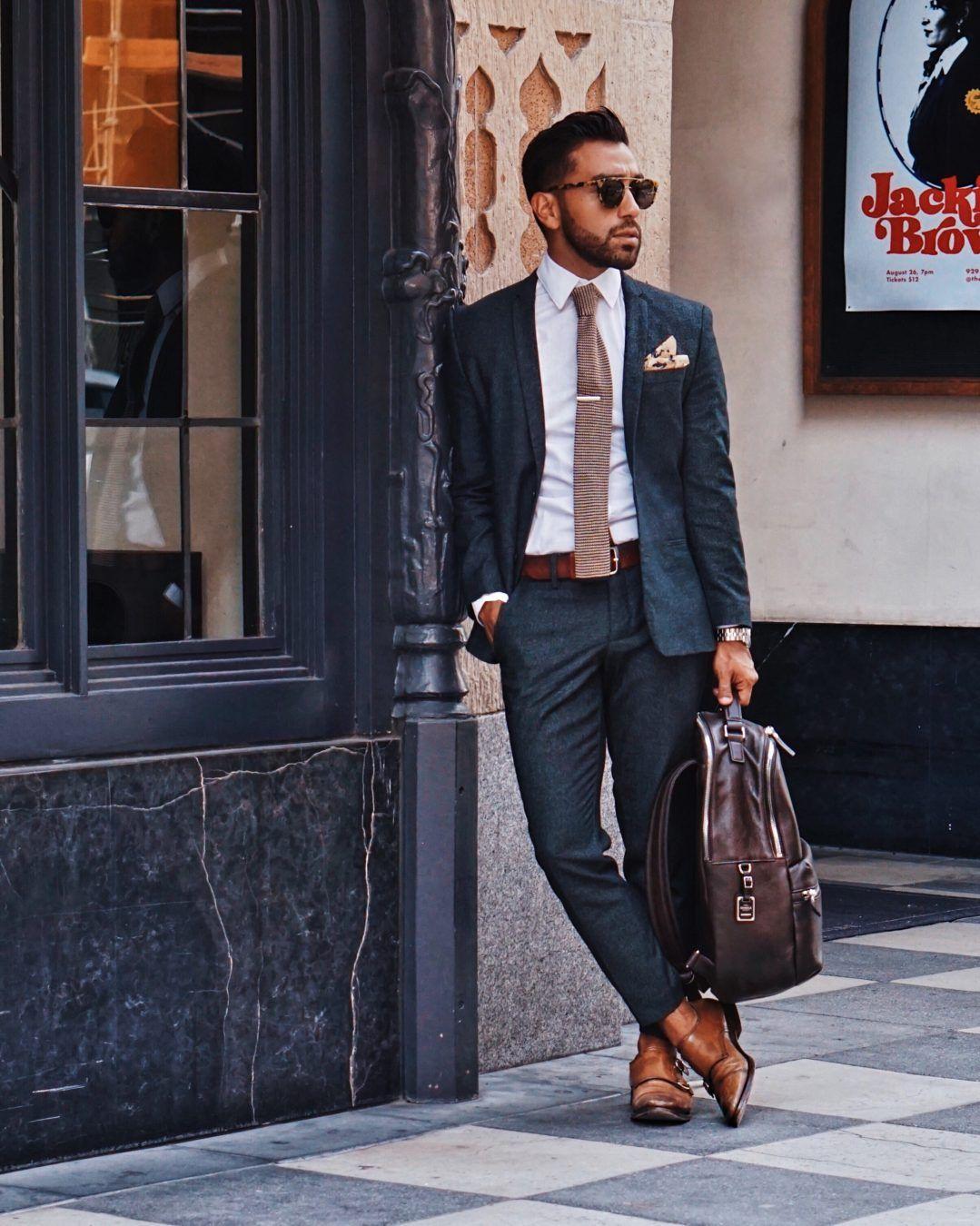 Gray suit + patterned tie + white dress shirt + pocket square + double monk  strap shoes