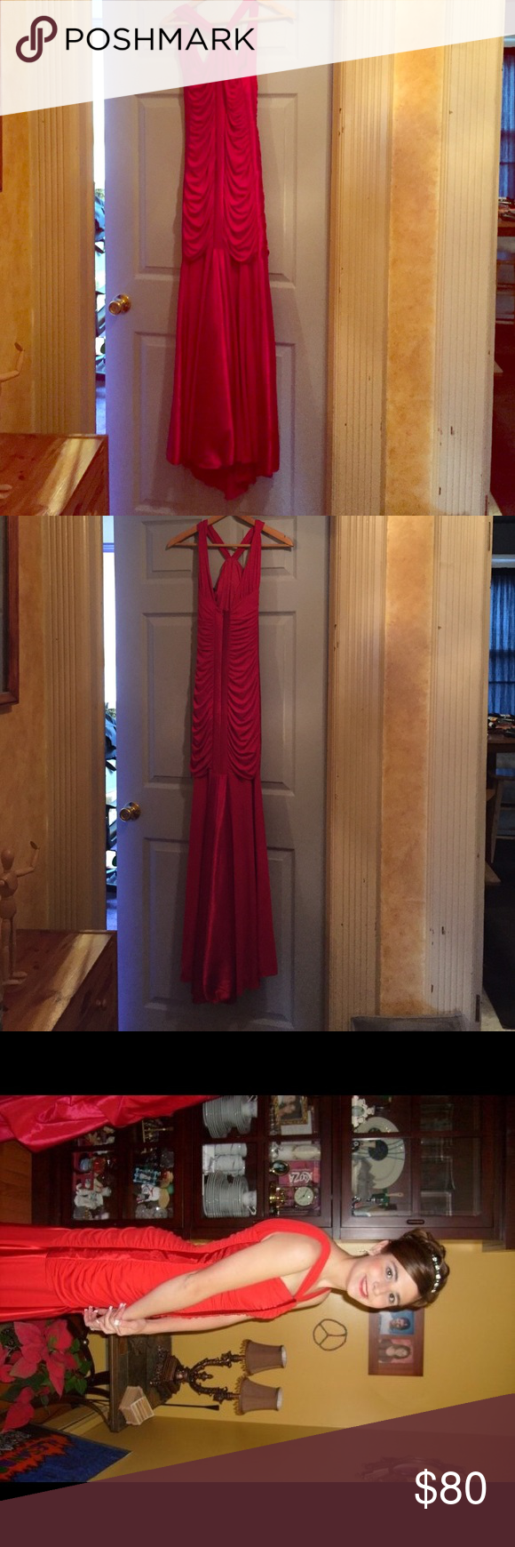 Size 13 (juniors) red prom dress. Long red gown I wore to my eighth grade prom once. Zipper goes up the back. Cinched halfway down the gown and then free flowing until the ground. Jessica McClintock Dresses Prom