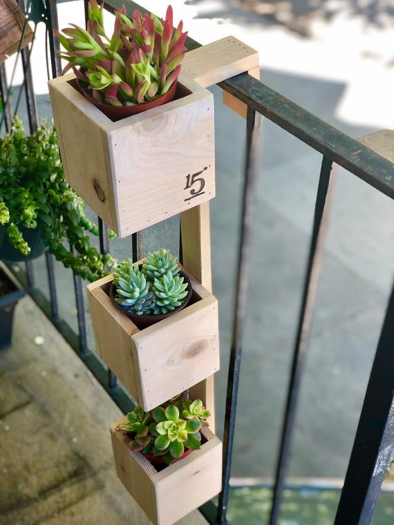 """Tiered Balcony Planter Box   Etsy is part of Balcony planter boxes, Small balcony garden, Balcony planters, Diy planters, Planter boxes, Diy garden furniture - This handmade THREETIER planter is the ideal solution for those that want a garden and are limited to a balcony   These boxes can be used for displaying live plants and flowers, but it may also be used for growing herbs or other edible plants  Hang a planter box over your balcony railing and add a blend of personality and function to your space    Planter boxes may also be used to line decks, patios, porches, steps, and sidewalks  The wood used is Cedar, which has a natural resistance to water, decay, and bugs  Dimensions (in photo) 30in Tall x 5in height x 5in width Fits up to 2"""" wide railing Please be sure to measure your railing before placing order Drainage holes available per request"""