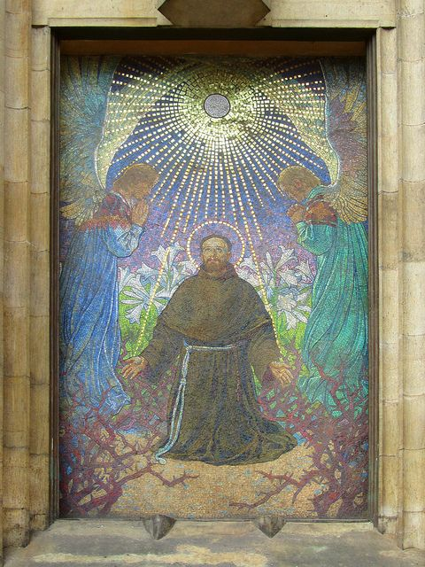 Mosaic of St Francis of Assisi in a niche on the exterior of a church in the Old Quarter of Krakow, Poland.