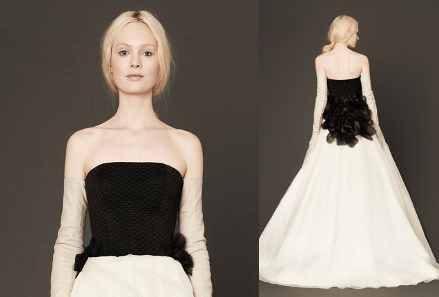 We can't get enough of these stunning back details! This ivory and black strapless gown with diamond quilted bodice and silk organza skirt has dramatic hand-cut black petal accents on the back of the waist