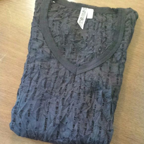 Sheer Textured Longsleeve Tee Black v-neck long sleeved tee in a cool holey cut out texture. Great for layering under other tees or over a cute bralet! Some pilling in the under arm area (see last photo). Urban Outfitters Tops