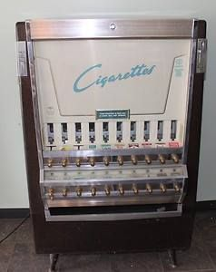 I remember buying cigarettes from one of these at the gas station on my way to school when I was a minor.  They were also located in most bars.  I think it cost 60 cents for a pack of 20.