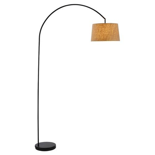 With a slender arching silhouette accented by a burlap shade this graceful floor lamp brings timeless style to your living room or home office