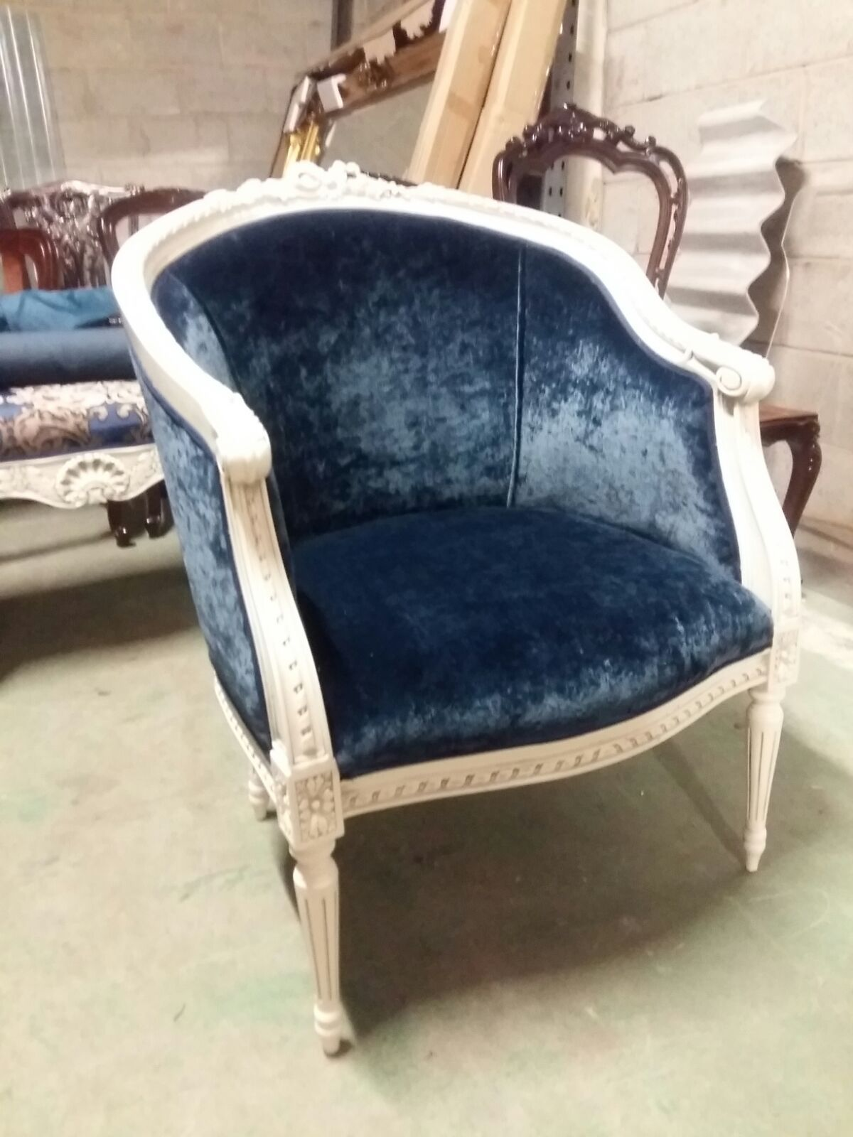 French ribbon tub chair painted in bone with blue velvet