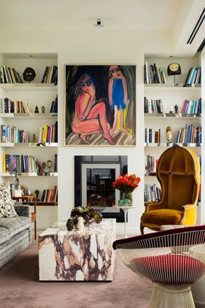 David Hicks--Hallmark Penhouse. Quite an eclectic room. Love the art work, mix of chairs. Styling of the bookcases.