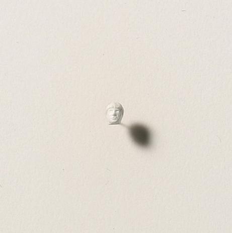 Thomas Friedman self portrait.  Carved from an aspirin.