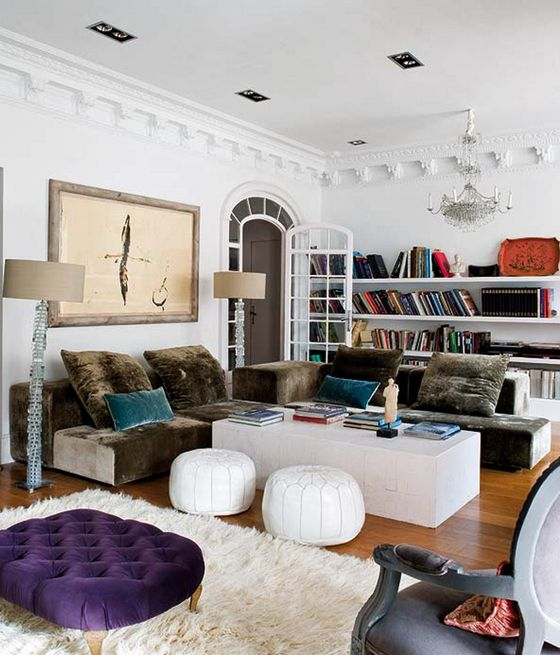 Ana Ros Living Room Traditional 1970s Mix Chandelier Bookshelves Shaggy Rug  Velvet Couch Poufs Purple Ottoman