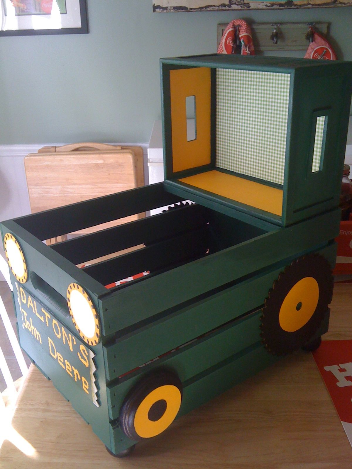 i made this tractor out of a crate and a wooden box (for the