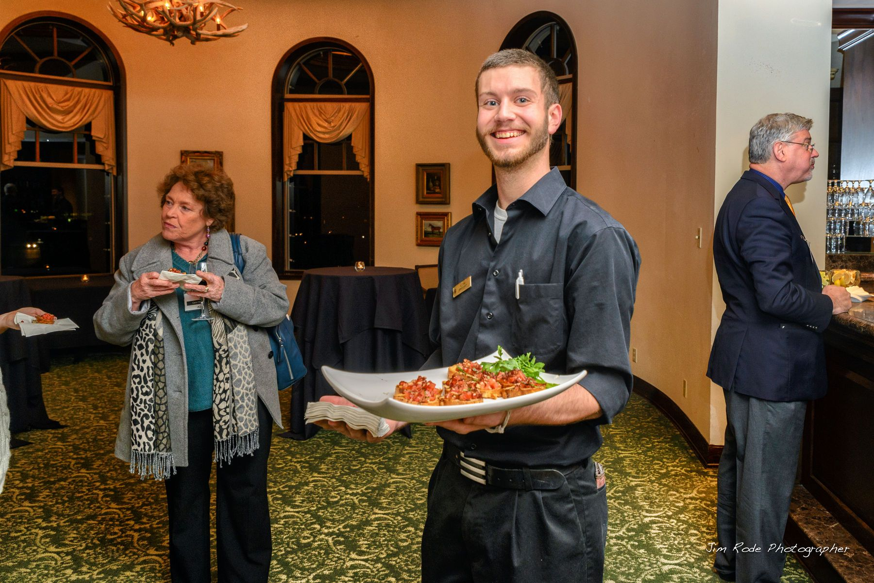 Butler Passed Brushetta at the Association of Wedding Professionals dinner meeting at StoneBridge Ranch Country Club.