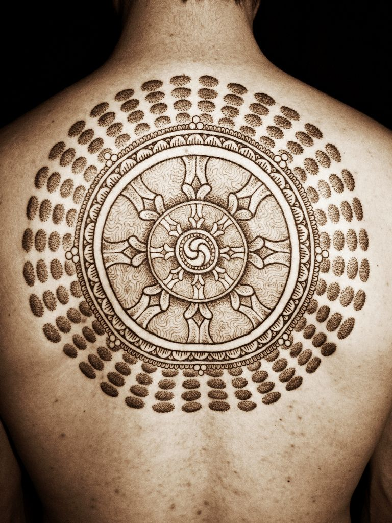 picture 40 Dharma Wheel Tattoo Designs For Men – Dharmachakra Ink Ideas