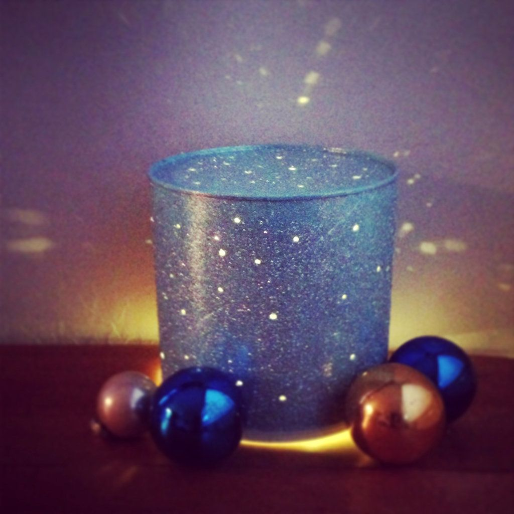 Get Festive With an Upcycled Tin-Can Lamp: Upcycle a tin can or a 48-ounce peanut can (because there's nothing wrong with buying nuts in bulk) into a glittering tin-can lamp that makes any corner sparkle.