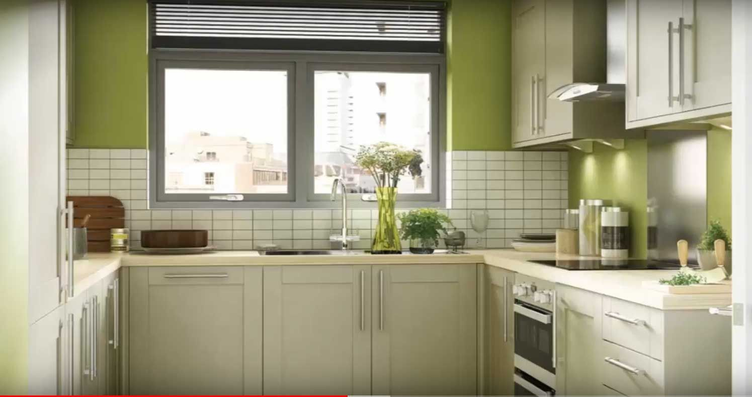Green kitchen with black countertops green