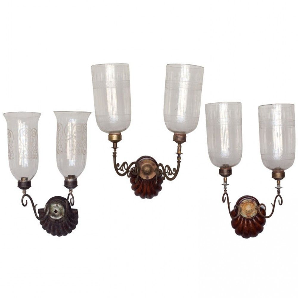 angloindian wall candle sconces with carved wood bases and brass