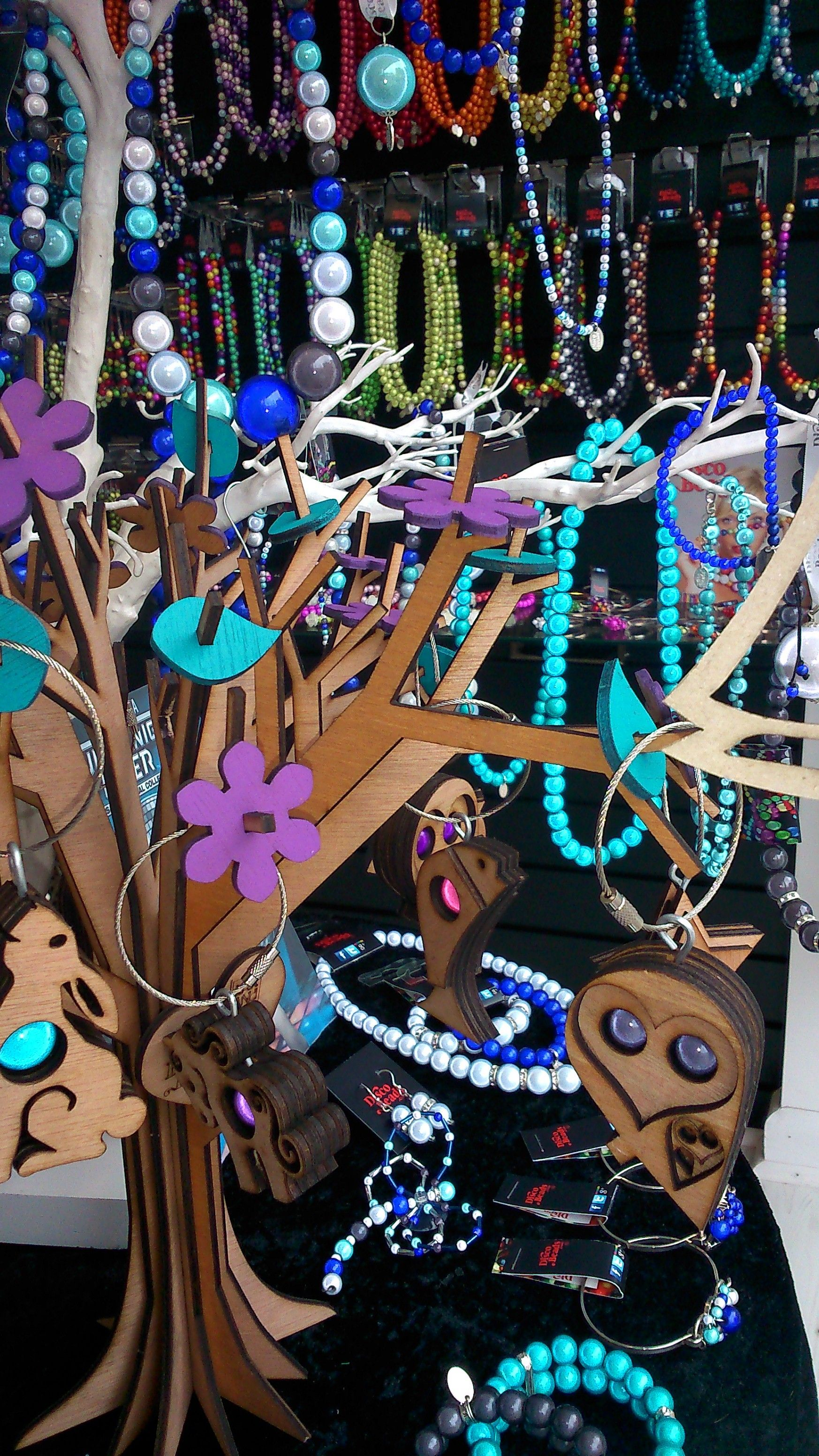 Magic glowing jewellery tree. Laser-cut wooden tree with glowing beads. Handcrafted owl keyrings, kids bedroom decor and much more at discobeads.com