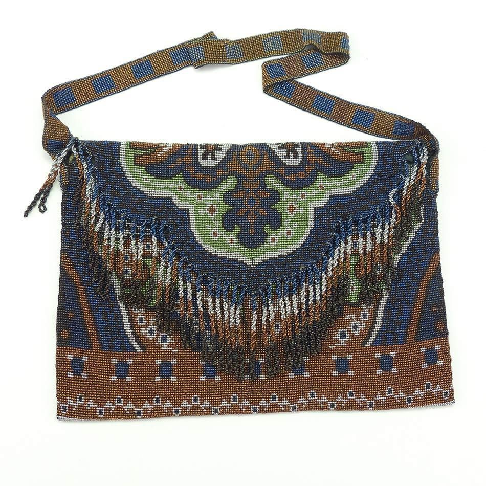 This is a truly lovely purse.  The beads are steel and in lovely rich colors of bronze, blue, silver and pale green.  The purse is a fold over style