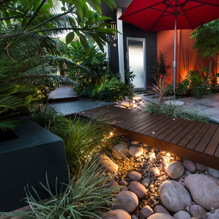exteriorsbeautiful courtyards garden home design using small red umbrella and green plants decoration also