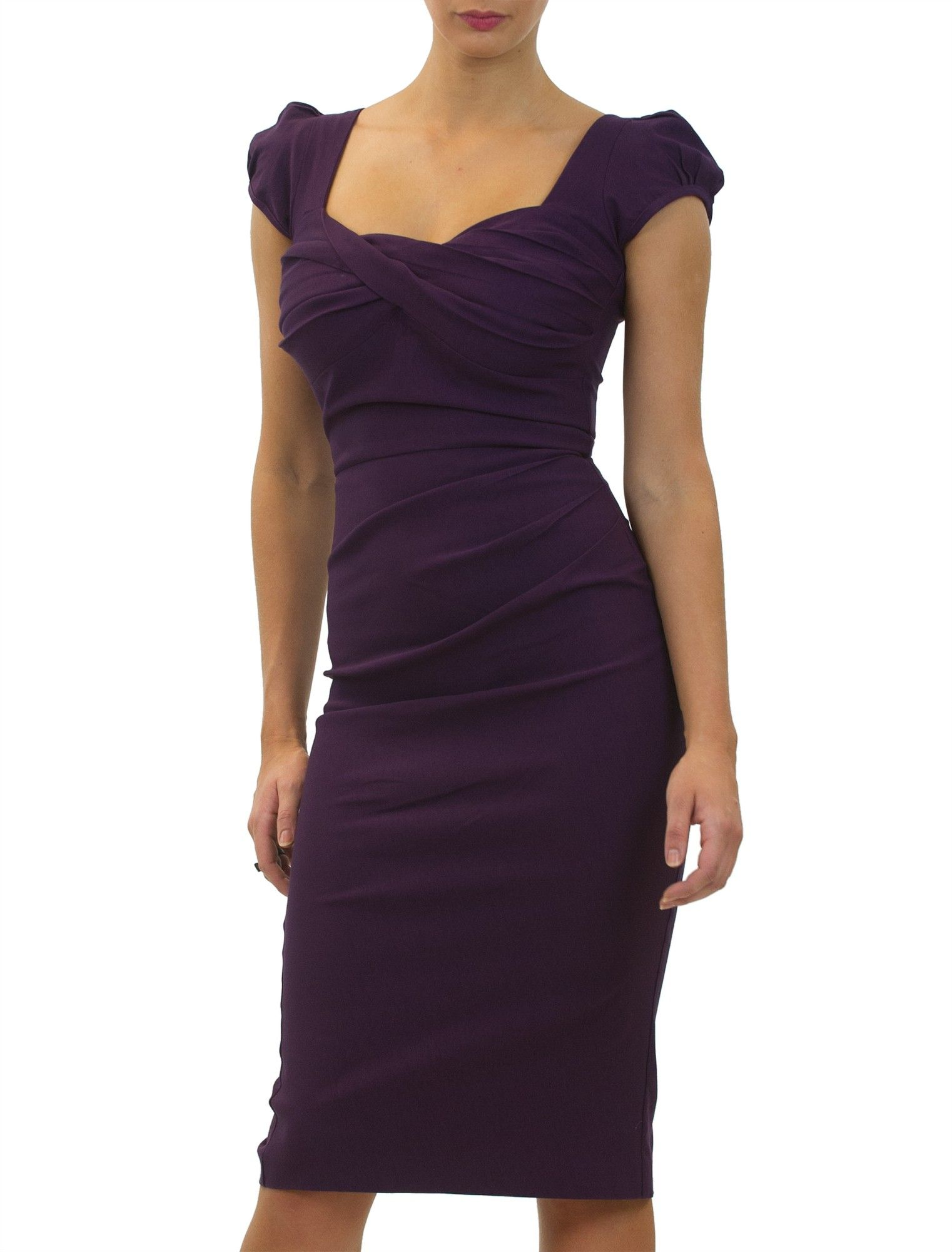 <p>The Nigella Dress draws on the vintage charm and feminine glamour of old Hollywood. This sexy, deep purple bombshell of a dress hugs your curves, flattering ample bosoms without revealing too much cleavage, and is guaranteed to draw compliments. Named after celebrity fan, Nigella Lawson, who famously wore this dress to rapturous acclaim, this expertly crafted retro 1950's inspired style is the perfect party dress for big busted women up to GG cups who want to show off their curves this…