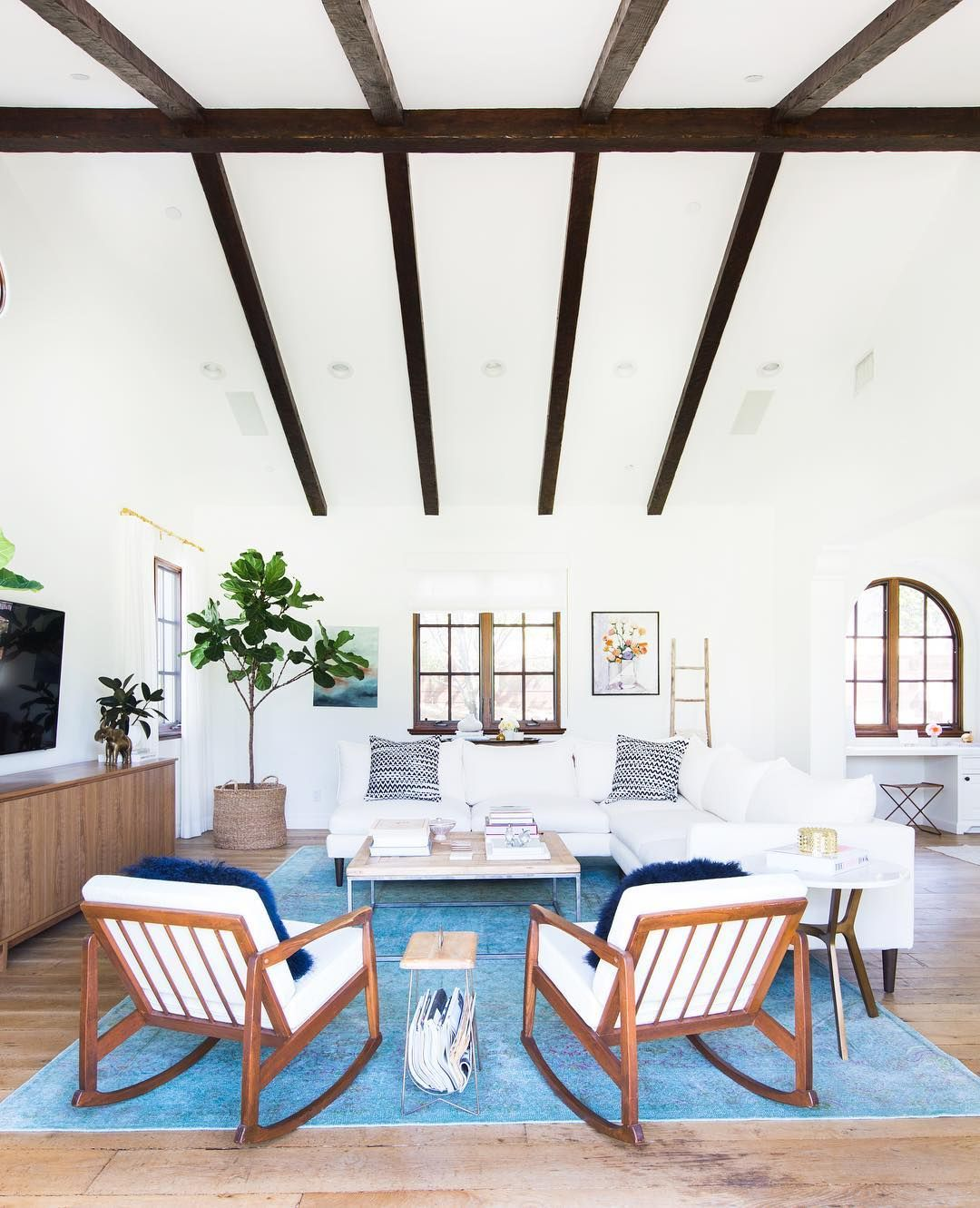 Gorgeous blue rug in modern living room with dark brown beams and ...