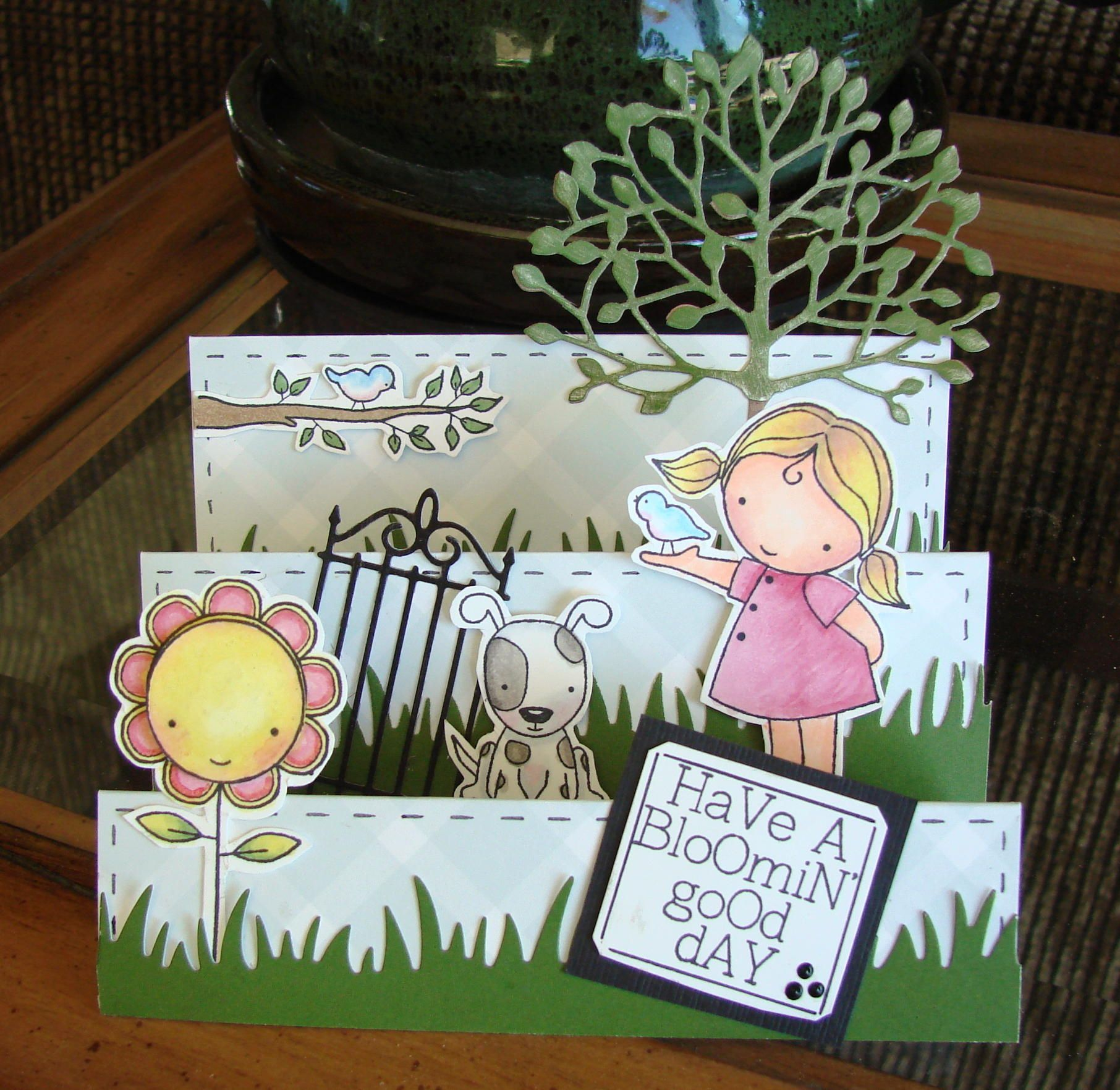 This stamp set is from Darcie's Heart & Home and I knew it would be adorable as a step-card! It turned out so cute. I used copics to color, Martha's grass punch and Memory Box Tree and gate dies.