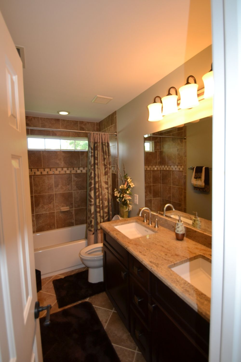 by using darker tones and lighting in the guest bathroom the entire room looks much