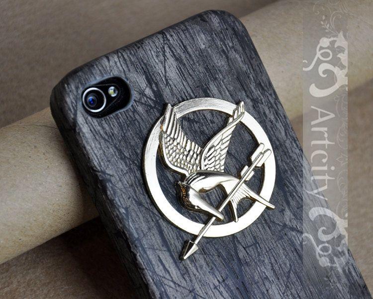 Hunger Games Mockingjay Pendant Black Wooden Iphone 4/4S case, Hard case, Iphone Case Cover. $10.99, via Etsy.