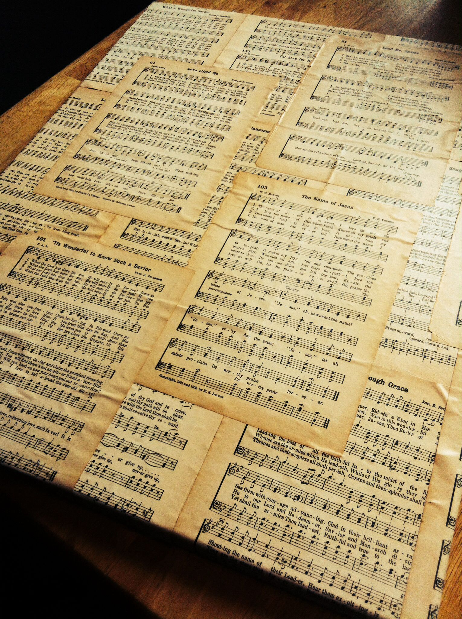 Get an old hymnal, take some of the hymns out and mod podge them ...
