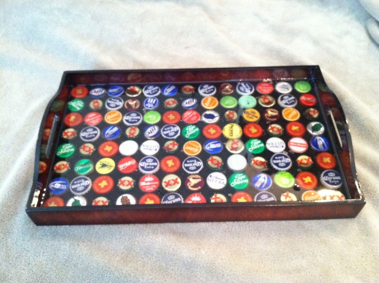 bottle cap serving tray. Cheap tray + favorite bottle caps = fun serving tray.