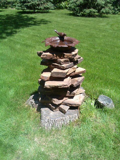 Stacking Flagstone On A Tree Stump For Birdbath Pedestal
