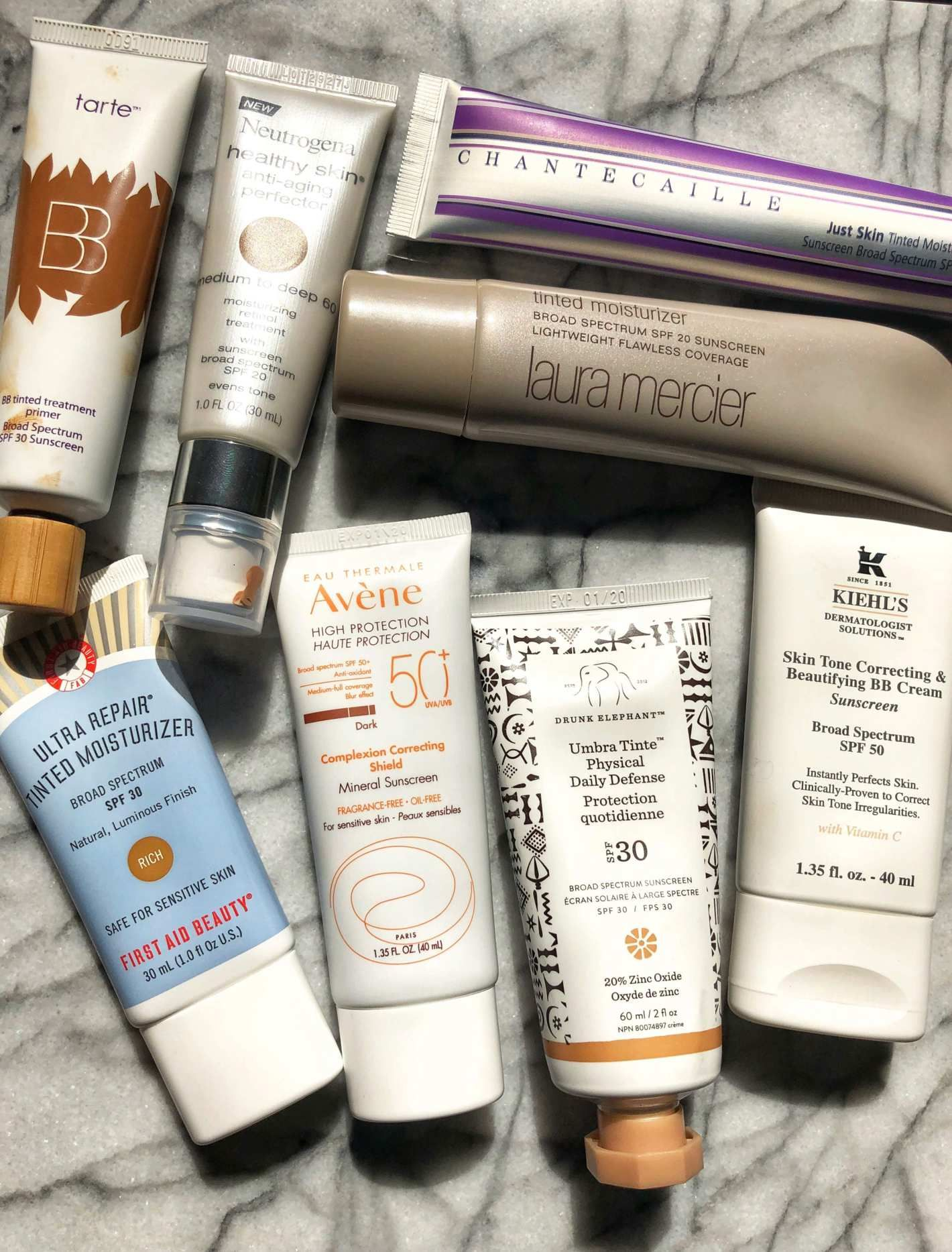 The Best Tinted Sunscreens For Darker Skin Tones Skin Tones Dark Skin Tone Dark Skin
