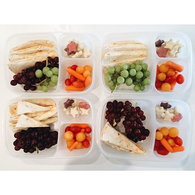 School lunch today: quesadilla with scrambled egg, grapes, carrots, tomatoes, and a few yogurt covered cookies. via What Lisa Cooks